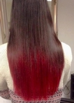 Creative Colouring on one length long hair using a vibrant red and the Ombre tecnique.